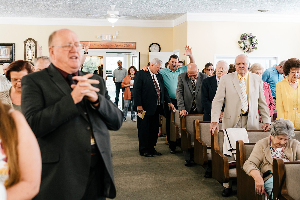 Members of the Full Gospel Pentecostal Church in Martinsburg, WV pray during service on June 4, 2017.