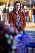 """15 JANUARY 2010 - TUCSON, AZ:    A woman prays at the memorial for victims of the mass shooting in Tucson, AZ, Saturday, January 15. Six people were killed and 14 injured in the shooting spree at a """"Congress on Your Corner"""" event hosted by Arizona Congresswoman Gabrielle Giffords at a Safeway grocery store in north Tucson on January 8. Congresswoman Giffords, the intended target of the attack, was shot in the head and seriously injured in the attack but is recovering. Doctors announced that they removed her breathing tube Saturday, one week after the attack. The alleged gunman, Jared Lee Loughner, was wrestled to the ground by bystanders when he stopped shooting to reload the Glock 19 semi-automatic pistol. Loughner is currently in federal custody at a medium security prison near Phoenix.   PHOTO BY JACK KURTZ"""