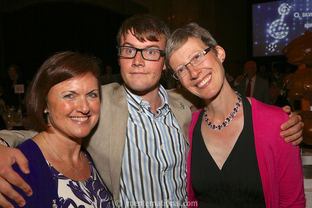 (l-r) Caroline Buckley, Edward Buckley and Jessica Atkinson (NR therapist)The Silver Clef Lunch 2013 in aid of  Nordoff Robbins held at the London Hilton, Park Lane, London.<br /> Friday, June 28, 2013 (Photo/John Marshall JME)
