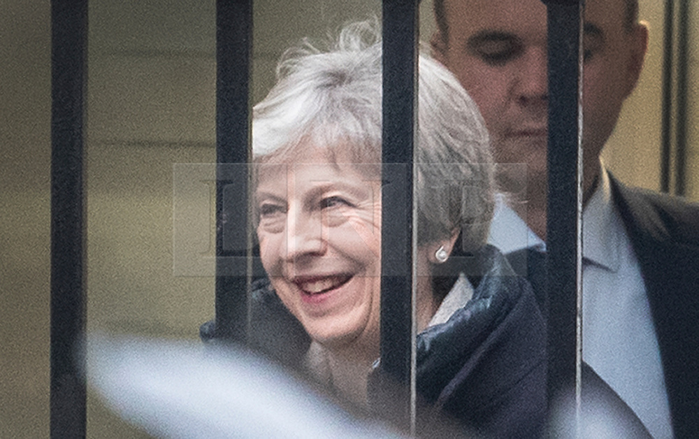 © Licensed to London News Pictures. 22/11/2018. London, UK. Prime Minister Theresa May smiles as she leaves Downing Street by the back door to head to Parliament. Photo credit: Peter Macdiarmid/LNP