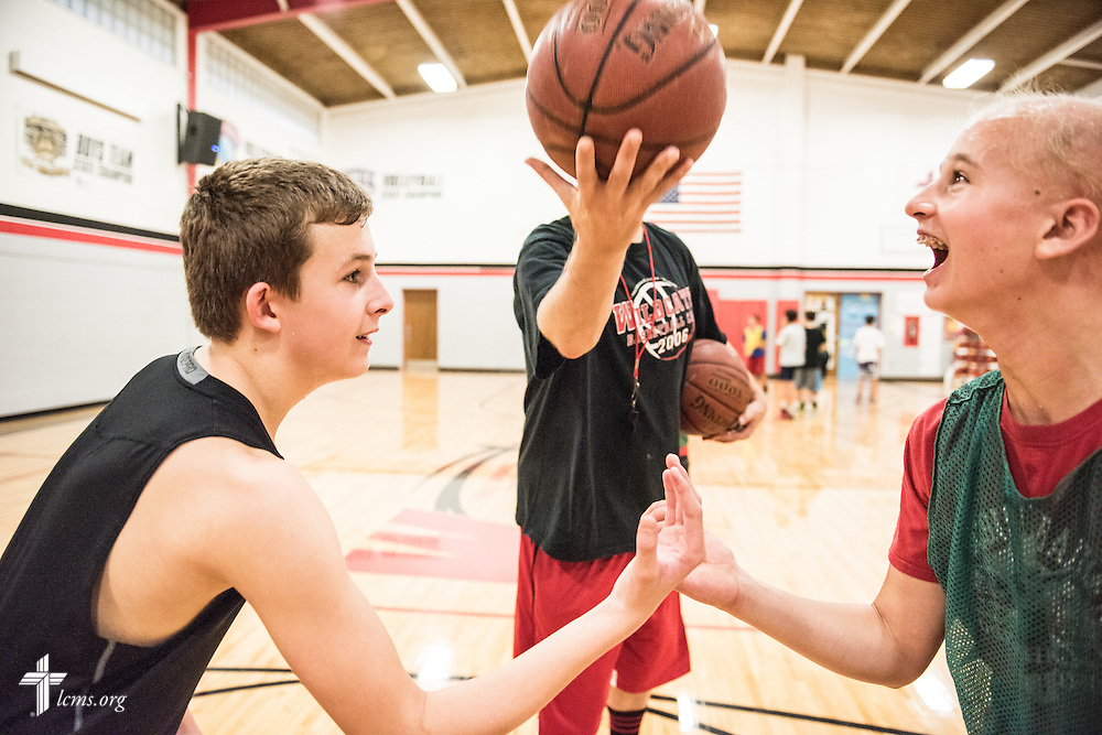 Teacher Eric Everts lifts the ball for tip off as student athletes try out for teams following school dismissal on Thursday, Oct. 27, 2016, at First Immanuel Lutheran School in Cedarburg, Wis. LCMS Communications/Erik M. Lunsford