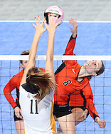 West Delaware's Allison Pasker (8) tries to get the ball over the block of Waverly-Shell Rock's Kelsey Roggemann (11) during the second game of a 3A semifinal in the state volleyball tournament at the U.S. Cellular Center at 370 1st Ave E on Friday afternoon, November 12, 2010. (Stephen Mally/Freelance)