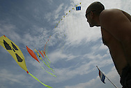"LOIS VASQUEZ GARZON ADMIRES THE KITES BY LUTZ TRECZOCKS, YELLOW ""STOP PLUTONIUM"" KITE, JAPAN. 030702. .PIC © JEREMY SUTTON-HIBBERT/GREENPEACE 2002..*****ALL RIGHTS RESERVED. RIGHTS FOR ONWARD TRANSMISSION OF ANY IMAGE OR FILE IS NOT GRANTED OR IMPLIED. CHANGING COPYRIGHT INFORMATION IS ILLEGAL AS SPECIFIED IN THE COPYRIGHT, DESIGN AND PATENTS ACT 1988. THE ARTIST HAS ASSERTED HIS MORAL RIGHTS. *******"