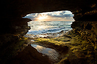 If you look at my photo of a San Diego sea cave you will find it has everything.  This picture has a sunset, horizon line, the Pacific Ocean, colorful clouds, a wave, green moss, a reflecting tide pool, and great composition.