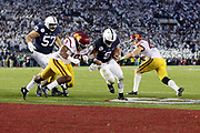 Penn State Nittany Lions quarterback Trace McSorley (9) splits two defenders as he runs for a 3 yard third quarter touchdown that gives the Lions a 42-27 lead during the 2017 NCAA Rose Bowl college football game against the USC Trojans, Monday, Jan. 2, 2017 in Pasadena, Calif. The Trojans won the game 52-49. (©Paul Anthony Spinelli)