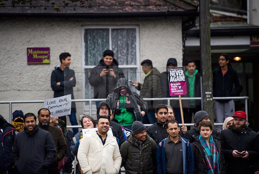 © Licensed to London News Pictures. 07/01/2017. London, UK. Members of the local muslim community stand outside Mote Road Islamic centre mosque in Maidstone, Kent to show support agains far-right group The South East Alliance who are protesting the expansion of the mosque. Plans to redevelop Maidstone Mosque into a purpose-built centre with three shops have been approved by  Maidstone Borough Council. A counter demonstration is Organised by The Kent Anti-Racism Network. . Photo credit: Ben Cawthra/LNP