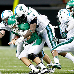 Oct 5, 2013; New Orleans, LA, USA; Tulane Green Wave defensive end Tyler Gilbert (43) tackles North Texas Mean Green quarterback Derek Thompson (7) during the second half at Mercedes-Benz Superdome. Mandatory Credit: Derick E. Hingle-USA TODAY Sports