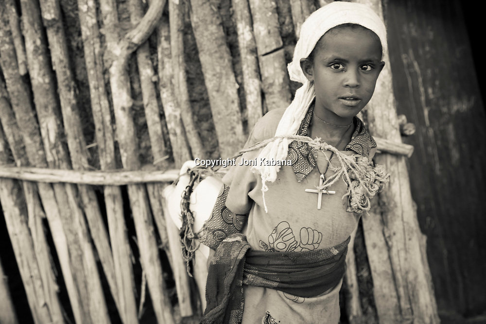 Young girls are required to carry heavy loads starting at a very young age in rural Ethiopia.