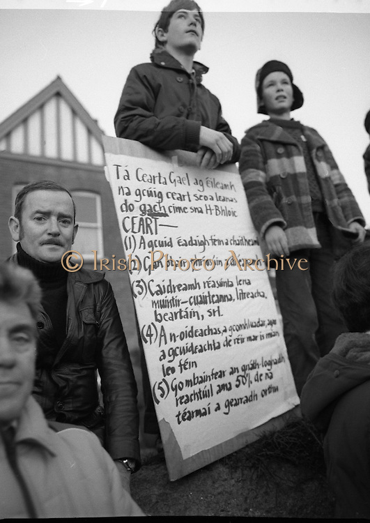"""H-Block Hunger-Strike Protest.   (M54)..1980..06.12.1980..12.06.1980..6th December 1980..In support of the prisioners on hunger strike in Northern Ireland a protest march was organised in Dublin. The march was to highlight the treatment of prisioners who wer on hunger strike and on the """"blanket"""" protest. Part of the prisioner demand was that they be treated as political prisioners and not as criminals or terrorists..Image shows a young man with a list of 5 demands which the prisioners want, included are the demands that they wear their own clothes and that they do not have to undertake any prison work. also demanded is better access to family visits."""