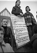 "H-Block Hunger-Strike Protest.   (M54)..1980..06.12.1980..12.06.1980..6th December 1980..In support of the prisioners on hunger strike in Northern Ireland a protest march was organised in Dublin. The march was to highlight the treatment of prisioners who wer on hunger strike and on the ""blanket"" protest. Part of the prisioner demand was that they be treated as political prisioners and not as criminals or terrorists..Image shows a young man with a list of 5 demands which the prisioners want, included are the demands that they wear their own clothes and that they do not have to undertake any prison work. also demanded is better access to family visits."