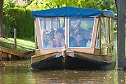 Visting Giethoorn's Grachten by excursion boats...M.S. Johann Strauss, a brand new four star+ river cruiser operated by Austrian River Cruises, and chartered by Club 50 (a travel agency especially for seniors aged 50 and up) undertook an epic 3-week journey (May 21 to June 10, 2004) all the way from Amsterdam to the Black Sea?along Rhine, Main and Danube?, presumably the first passenger vessel ever to have done so. This is one of the images recorded during this historic voyage.