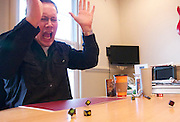 Matthew Becker, frustrated that he is losing badly - again, throws his dice down in rage.  The Long Islander has been playing these types of games with his friends since they first met in high school.  They've been playing table-top games for 15 years, and displays like this are characteristic feature of their Saturday nights.  December 7, 2013.  Photo by Andrew Welsch/NYCity Photo Wire