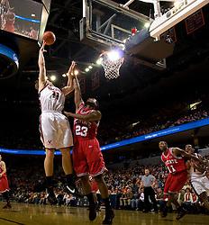 Virginia forward Laurynas Mikalauskas (11) shoots a hook shot over North Carolina State forward Tracy Smith (23).  The Virginia Cavaliers men's basketball team defeated the North Carolina State Wolfpack 78-60 at the John Paul Jones Arena in Charlottesville, VA on February 24, 2008.