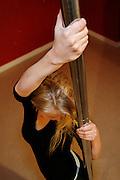 """Paris, France. October 15th 2007.A Pole Dance class at the """"Pole Dance Paris"""" School.. .Pole Dance Paris.Studio 77 .77 Rue de Montreuil.75011 Paris."""