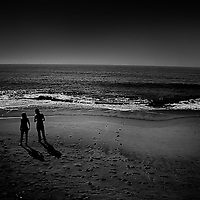 A couple silhouetted on a beach