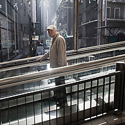 """A series of escalators run from the top of the Mid Levels high above the city centre all the way down to the harbor side in Hong Kong Central in the morning bringing thousands of commuters to work. The escaltors change directions at ten am to bring people back up the steep hill the rest ofthe day and night. <br /> <br /> <br /> Hong Kong (香港; """"Fragrant Harbour""""), officially known as Hong Kong Special Administrative Region of the People's Republic of China since the hand-over from the United Kingdom in 1997 under the principle of """"one country, two systsems"""".  7 million people live on 1,104km square, making it the most vertivcal city in the world. Hong Kong is one of the world's leading financial centres along side London and New York, it has one of the highest income per capita in the world as well the moste severe income inequality amongst advanced economies. The Hong Kong civil society is highly regulated but has at the same time one of the most lassiez-faire economies with low taxation and free trade. Civil unrest and political dissent is unusual but in 2014 the Umbrella Movenment took to the streets of Hong Kong demanding democracy and universal suffrage. 93 % are ethnic Chinese, mostly Cantonese speaking."""