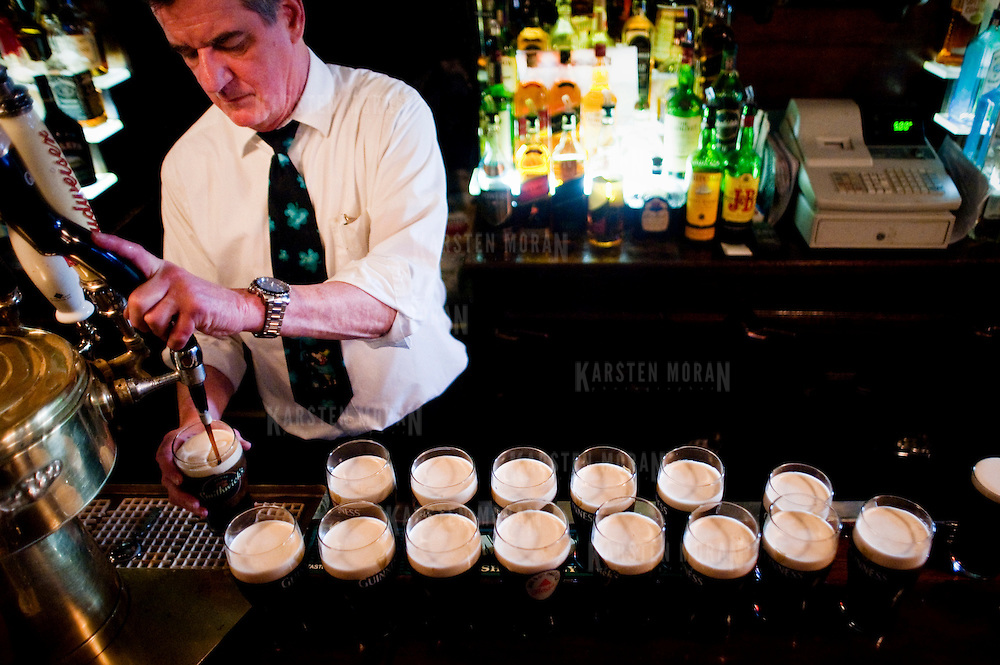 March 17, 2011 - Bronx, NY : Riverdale Steak House bartender Steve Hughes pours perfect pints of Guinness for the Peconic War Pipe and Drum Band who made a stopover at the North Riverdale pub and eatery on St. Patrick's day. Karsten Moran / The Riverdale Press