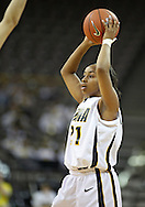 February 18, 2010: Iowa guard Kachine Alexander (21) looks to pass the ball during the second half of the NCAA women's basketball game at Carver-Hawkeye Arena in Iowa City, Iowa on February 18, 2010. Iowa defeated Minnesota 75-54.