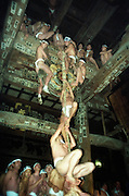"Men dressed in only a ""fundoshi"" cloth thong climb up the ""uchizuna,"" a thick rope usually used to sound a temple gong, during the Hadaka Mairi at Fukuman Kokuzoson Enzoji Temple in Yanaizu, Fukushima Prefecture, Japan. The winter ritual, variations of which exist throughout Japan, is undertaken by males alone as a purification ritual. It has its origins in an ancient folk legend, in which the people of Yanaizu underwent a quest to drive away the Dragon God, who lived in the Tadami River, which flows through the town, and who had entered the town in order to steal the treasure of Enzoji Temple, where the main event of the Hadaka Mairi is held. It has been an annual tradition for more than a thousand years and today participants write wishes on their arms and torsos asking for success in business or for their favorite sports team."