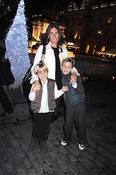 ELIZABETH SALTZMAN and her sons left to right, CHARLIE WALKER and HARRY WALKER at the opening of the Somerset House ice Rink for 2008 sponsored by Tiffany & Co held at Somerset House, The Strand, London on 18th November 2008.