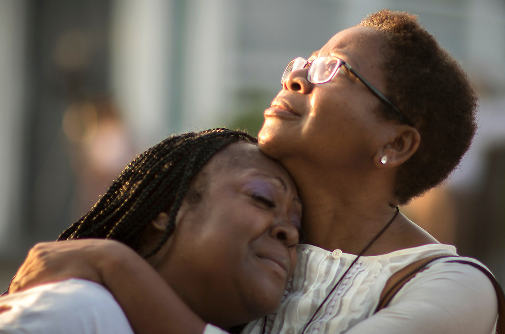 Gillettie Bennett, right, comforts Clarissa Jackson, left, while she waits in line for Emanuel AME Church's first service Sunday, June 21, 2015, in Charleston, S.C. (AP Photo/Stephen B. Morton)