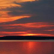 """""""The Rising""""<br /> <br /> Beautiful hues and shimmering glows in a lovely sunrise image over Lake Huron in Michigan's Upper Peninsula!<br /> <br /> Sunrise Images by Rachel Cohen"""