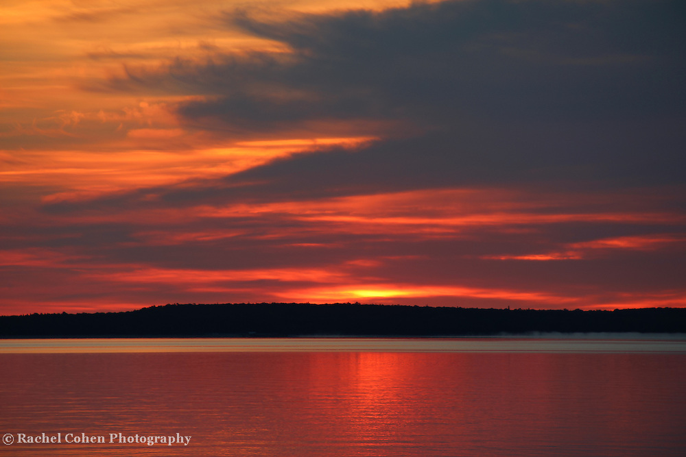 &quot;The Rising&quot;<br /> <br /> Beautiful hues and shimmering glows in a lovely sunrise image over Lake Huron in Michigan's Upper Peninsula!<br /> <br /> Sunrise Images by Rachel Cohen
