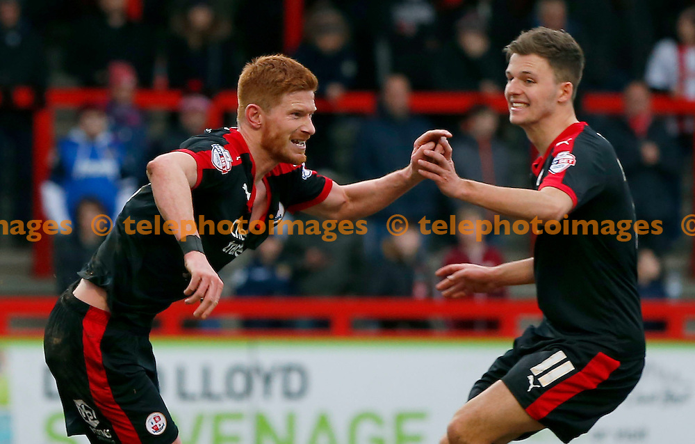 Crawley&rsquo;s Matt Harrold celebrates after scoring with Chris Atkinson  during the Sky Bet League 2 match between Crawley Town and Stevenage at the Checkatrade.com Stadium in Crawley. February 6, 2016.<br /> James Boardman / Telephoto Images<br /> +44 7967 642437