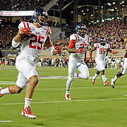 Mississippi defensive back Cody Prewitt (25) returns a Texas A&M interception for a touchdown during the first half of an NCAA college football game in College Station, Texas, Saturday, Oct. 11, 2014. (Photo/Thomas Graning)
