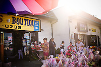 "A family shops for flowers on Mother's Day (celebrated on May 10 in Latin America), along Middlefield Rd., known as ""Little Mexico,"" in Redwood City, Ca., on Tuesday, May 10, 2011. Along the San Francisco peninsula, just beyond the city's suburbs, a group of Asian Americans and Latinos are suing San Mateo County for what it calls a discriminatory voting system. The county has elected no Asians and just one Latino supervisor in the past 25 years even though its population is now a quarter Latino and a quarter Asian."