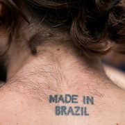 An activist with a Made in Brazil tatoo on his hairy neck. Thousands turned out for a march of solidarity against fracking in Balcombe. The village Balcombe in Sussex is the  centre of fracking by the company Cuadrilla. The march saw anti-fracking movements from the Lancashire and the North, Wales and other communities around the UK under threat of gas and oil exploration by fracking.