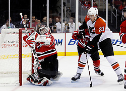 Oct 3, 2009; Newark, NJ, USA; New Jersey Devils goalie Martin Brodeur (30) makes a save while Philadelphia Flyers left wing James vanRiemsdyk (21) looks for a rebound during the first period of their game against the Philadelphia Flyers at the Prudential Center.