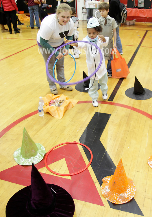 Middletown, New York - A little girl wearing a doctor's costume plays a gamesat the Family Fall Festival at the Middletown YMCA on Oct. 23, 2010.