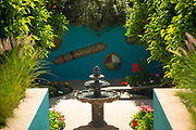 Fountain water feature at the Anima Gardens by designer Andre Heller, Ourika Valley, Marrakesh, Morocco, 2016–04-22.<br /><br />A relatively new garden space designed by André Heller, receiving praise and attention for its imaginative and creative design. <br /><br />Located amid the foothills of the High Atlas mountains, within the spectacular Ourika Valley (27km away from Marrakesh), the Anima Garden holds shady paths and pavilions with wild flowers, cacti, water features, palm trees and tall grass, with the suprising addition of unusual sculptures of magical characters hidden about the space.