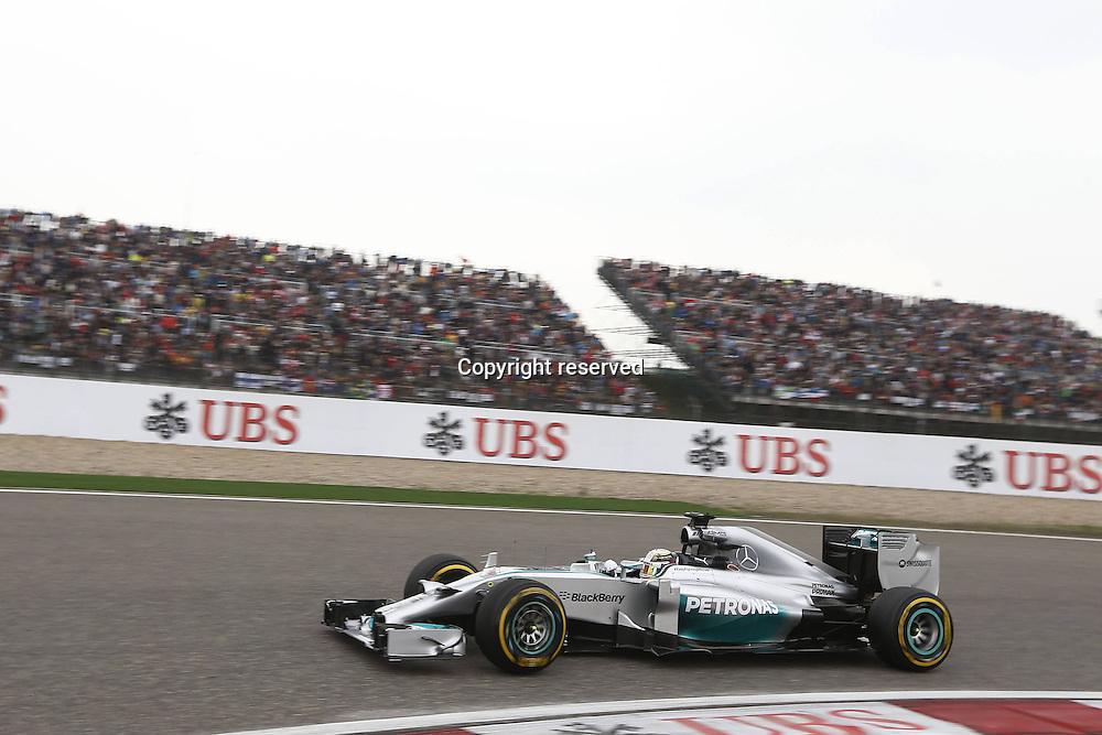 20.04.2014. SHanghai, China.  Motorsports: FIA Formula One World Championship 2014, Grand Prix of China, 44 Lewis Hamilton (GBR, Mercedes AMG Petronas F1 Team) on his way to winning his 3rd consecutive race