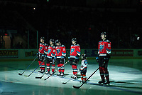 KELOWNA, CANADA - DECEMBER 2: Carsen Twarynski #18, Liam Kindree #26, Dillon Dube #19, Gordie Ballhorn #4 and Braydyn Chizen #22 of the Kelowna Rockets stand on the blue line with the Pepsi Player of the game during the national anthem against the Kootenay Ice on December 2, 2017 at Prospera Place in Kelowna, British Columbia, Canada.  (Photo by Marissa Baecker/Shoot the Breeze)  *** Local Caption ***