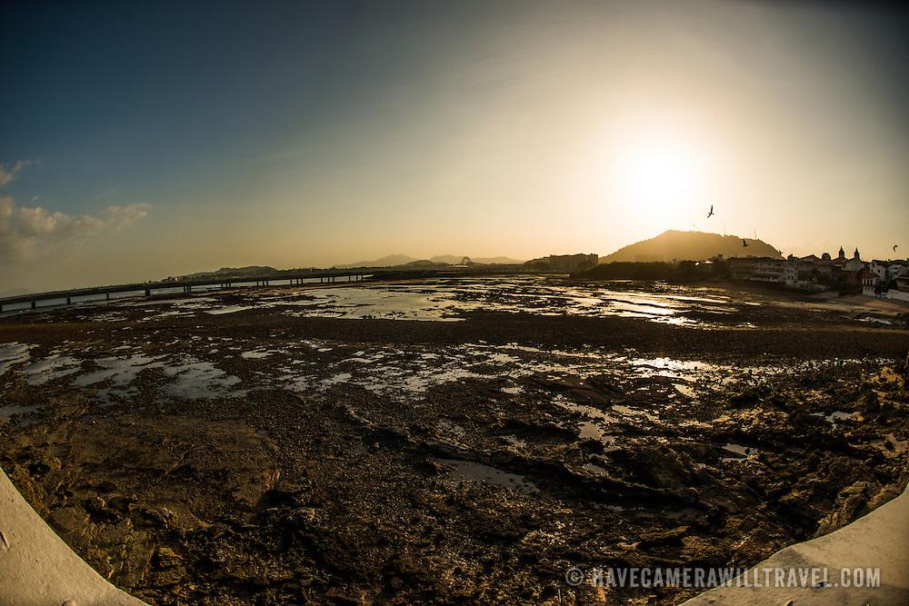 The rocky shoreline of Casco Viejo on the waterfront of Panama City, Panama, on Panama Bay.