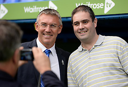 Reading Manager, Nigel Adkins poses for a photo with a fan. - Photo mandatory by-line: Alex James/JMP - Mobile: 07966 386802 - 18/10/2014 - SPORT - Football - Reading - Madejski Stadium - Reading v Derby County - Sky Bet Championship