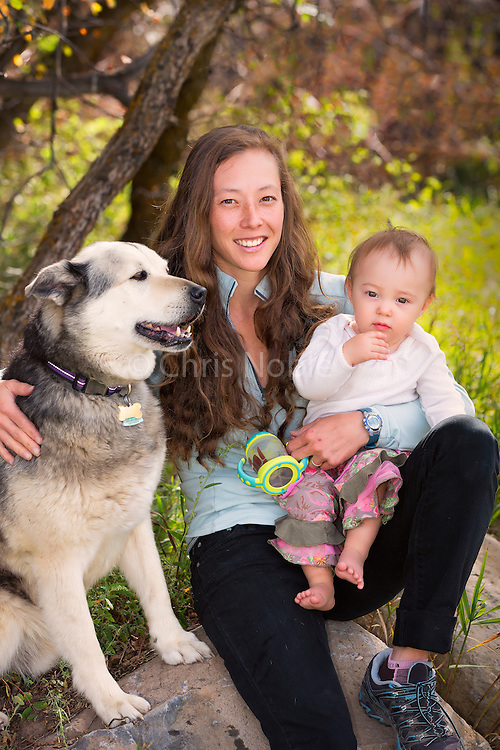 Portrait of rock climber Lauren Lee McCormick, daughter Lydia (age 1), and family pooch at home in Glenwood Springs Colorado.