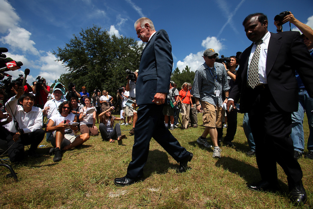 GAINESVILLE, FL -- Sept. 10, 2010 -- Florida pastor Terry Jones, whose plans are on hold to burn the Koran on Sept. 11th, arrives with A.K. Paul, right, during a press conference outside of the Dove World Outreach Center in Gainesville, Fla., on Friday, September 10, 2010.  (Chip Litherland for The New York Times)