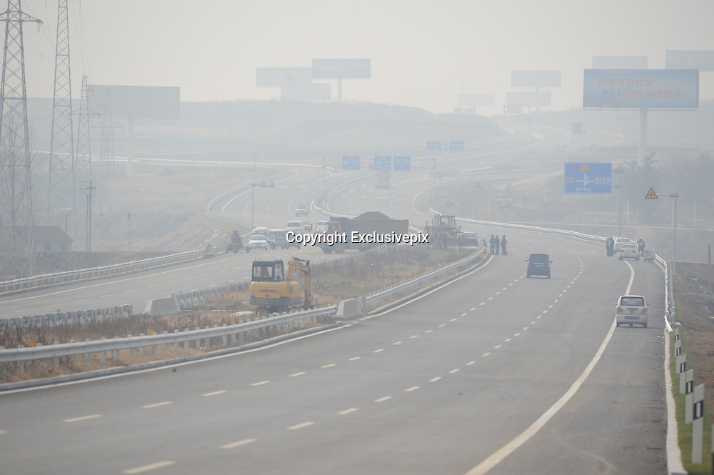 PENGLAI, CHINA - NOVEMBER 19: (CHINA OUT) <br /> <br /> 11 Children Killed In School Bus Accident In East China<br /> <br /> The image shows the accident site after a collision which caused 11 children died on November 19, 2014 in Penglai, Shandong Province of China. 11 kindergarten children and 1 driver died and 3 kindergarten children were injured during a collision between a truck and a minibus on the slip road to the new Yantai airport in Chaoshui Town, Penglai City of East China\'s Shandong Province. The minibus belonged to a local private kindergarten and was overloaded at that time according to Xinhua\'s report. The cause of the traffic is still under investigation.  <br /> ©Exclusivepix