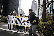 Protesters carrying signs and chanting slogans demanding a higher wage Tokyo April 15, 2017, Japan. A Group of young people named Aequitas who means Equity in Latin, organised a demonstration to demanded a minimum hourly wage of 1,500 JPY (approx. USD 13.7), currently the minimum wage ranges from 700 to 900 JPY (approx. USD from 6,4 to 8,3). 15/04/2017-Tokyo, JAPAN