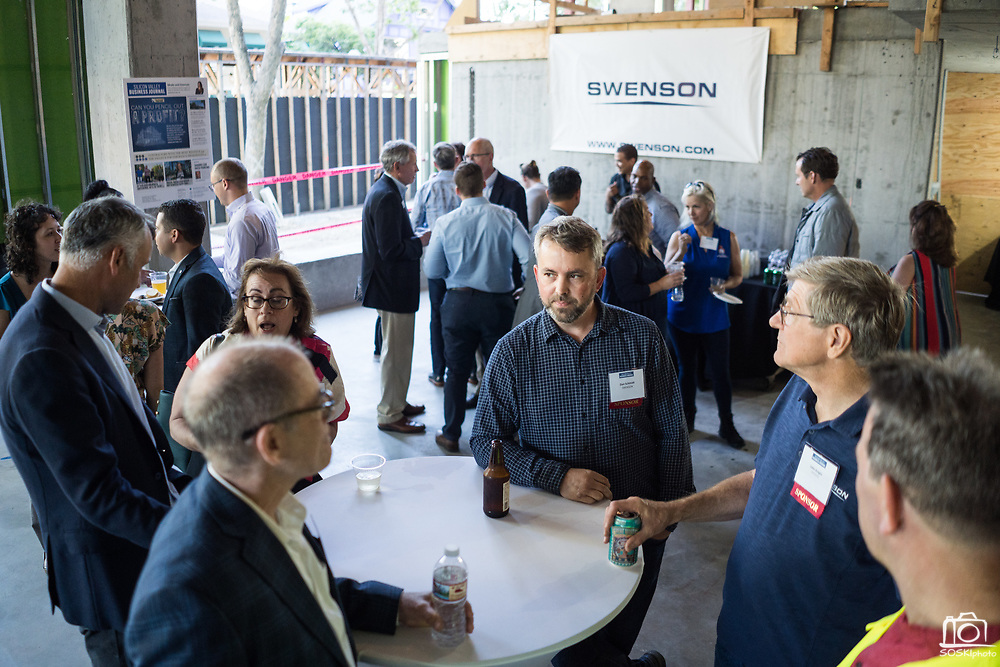 Attendees network during SVBJ's BizMix presented by SWENSON at The Grad in Downtown San Jose, California, on July 31, 2019. (Stan Olszewski for Silicon Valley Business Journal)