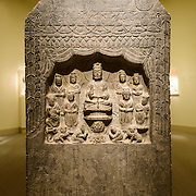Sackler Gallery Daoist Stela. Limestone Daoist stela from China, dated 572. The Arthur M. Sackler Gallery, located behind the Smithsonian Castle, showcases ancient and contemporary Asian art. The gallery was founded in 1982 after a major gift of artifacts and funding by Arthur M. Sackler. It is run by the Smithsonian Institution.