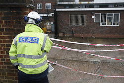 © Licensed to London News Pictures. 04/03/2018. Harold Hill, UK. A gas company workers looks at the scene at the back of the Post Office where emergency services are currently responding to an explosion in Harold Hill, Essex. Nearby homes have been evacuated. Photo credit: Peter Macdiarmid/LNP