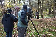 Ron Schara shoots a segment of his TV show with his dog Raven and his production crew.