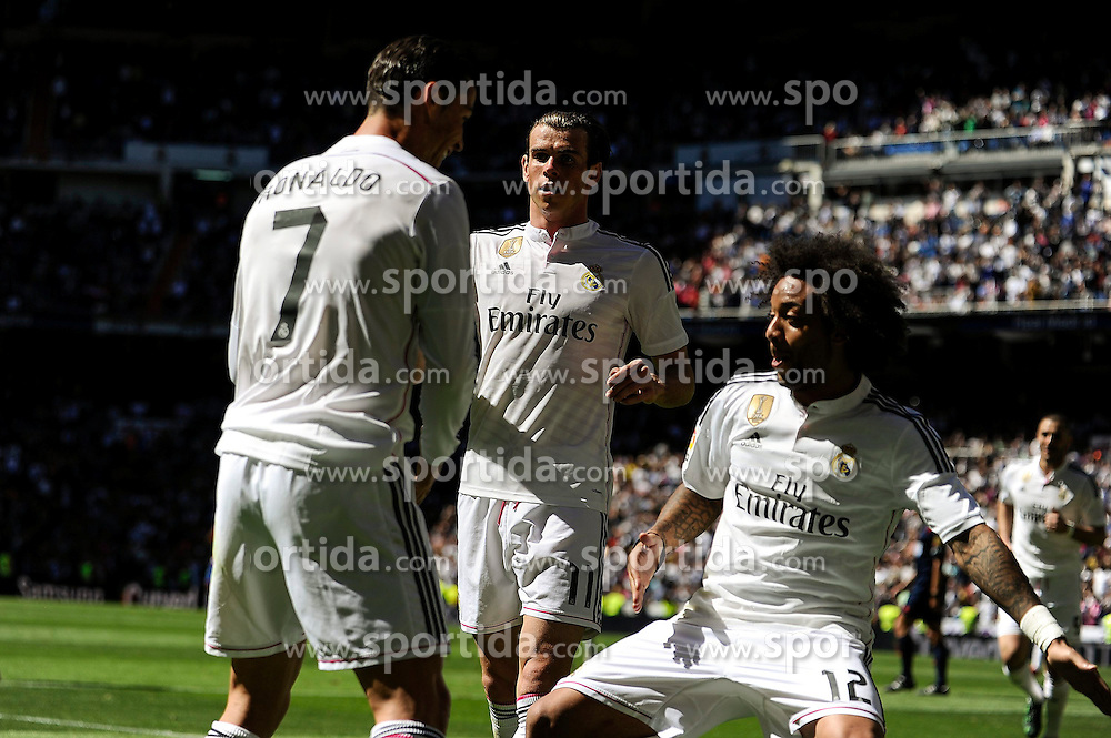 05.04.2015, Estadio Santiago Bernabeu, Madrid, ESP, Primera Division, Real Madrid vs FC Granada, 29. Runde, im Bild Real Madrid&acute;s Cristiano Ronaldo and Marcelo Vieira celebrates a goal // during the Spanish Primera Division 29th round match between Real Madrid CF and FC Granada at the Estadio Santiago Bernabeu in Madrid, Spain on 2015/04/05. EXPA Pictures &copy; 2015, PhotoCredit: EXPA/ Alterphotos/ Luis Fernandez<br /> <br /> *****ATTENTION - OUT of ESP, SUI*****