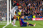 Liverpool defender Joel Matip (32) remonstrates with Barcelona midfielder Courtinho (7) during the Champions League semi-final leg 1 of 2 match between Barcelona and Liverpool at Camp Nou, Barcelona, Spain on 1 May 2019.