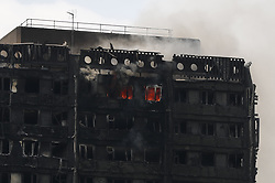 June 14, 2017 - London, London, UK - London, UK. Fire engines try to get the Grenfell Tower fire under control 13 after the fire broke in west London on 14 June 2017. (Credit Image: © Tolga Akmen/London News Pictures via ZUMA Wire)