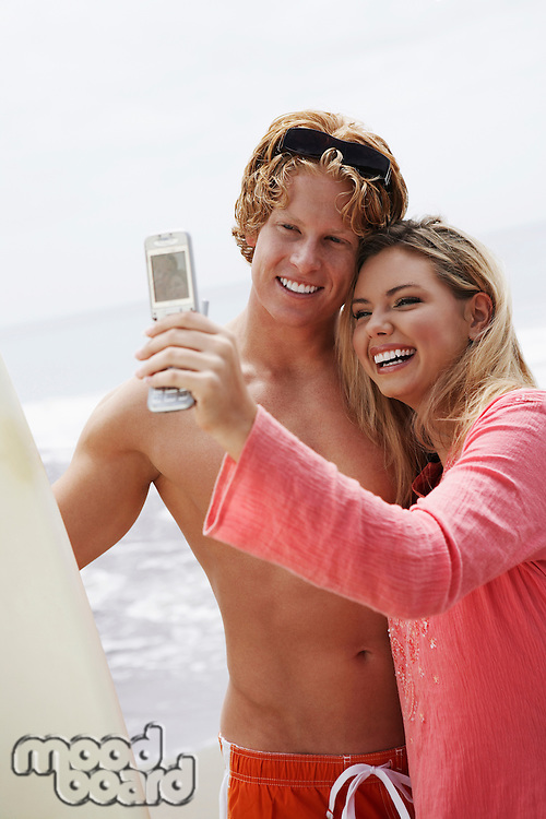 Couple Using Camera Phone
